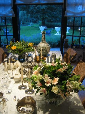 Product picture Stylishly decorated table with flowers, silverwork and potte