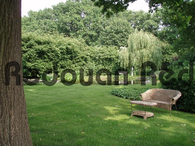 Product picture Garden furniture surrounded by trees and bushes